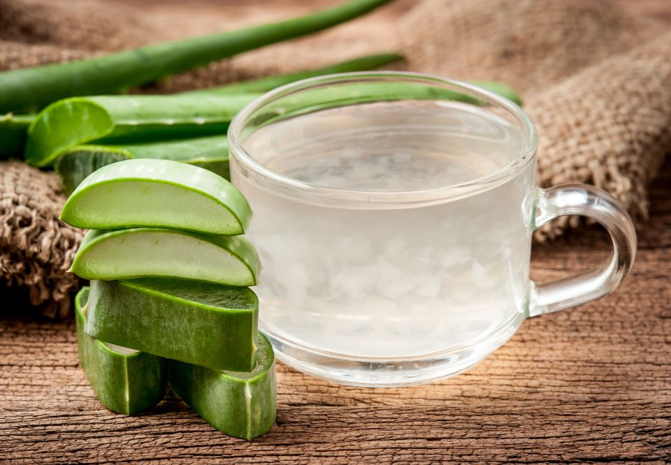 54925029 - aloe vera healthy drink on wooden background