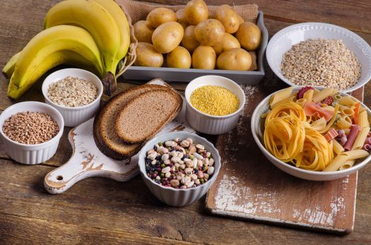 53650544 - foods high in carbohydrate on rustic wooden background. top view